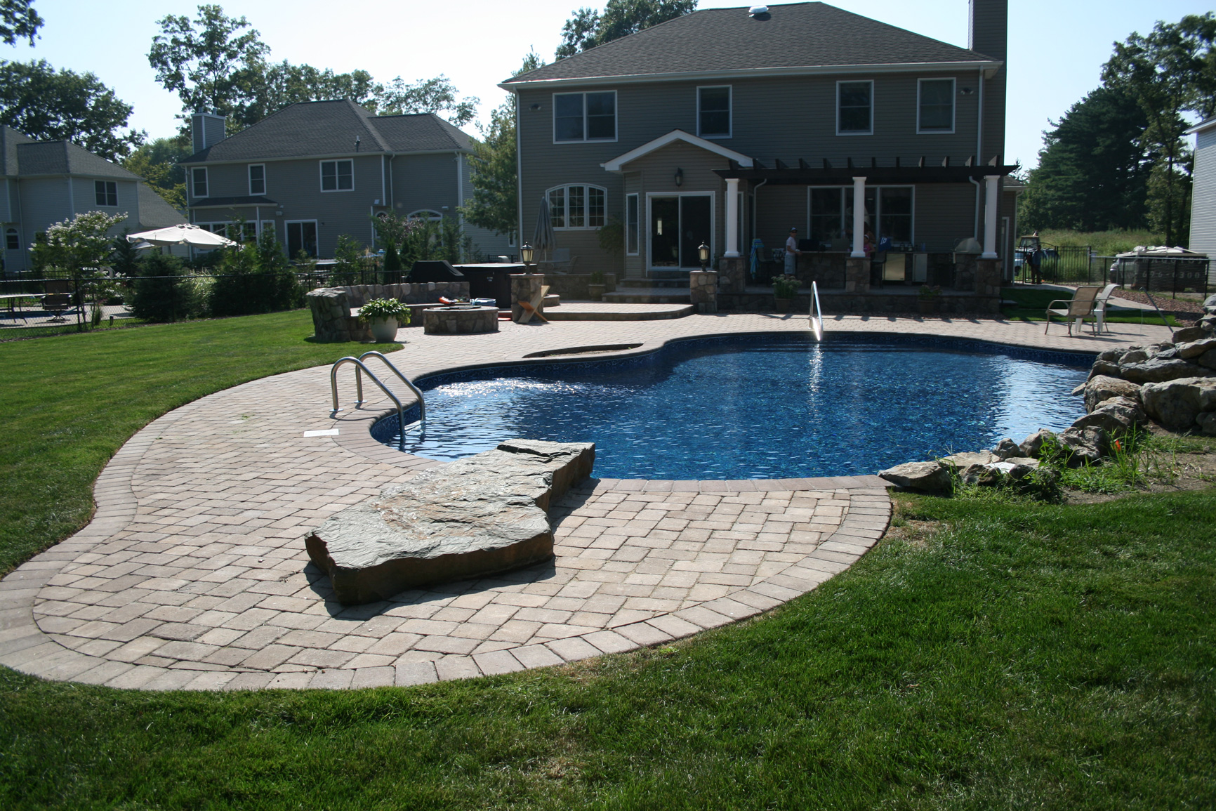 Free form water feature whirlpool specht tacular pools for Form landscaping